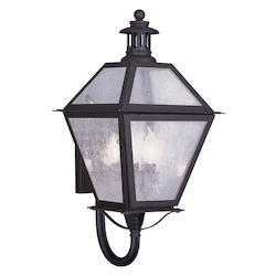 Bronze 3 Light 180 Watt 10.5in. Wide Outdoor Wall Sconce with Seeded Glass from the Waldwick Collection