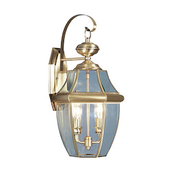 Antique Brass 2 Light 120W Outdoor Wall Sconce with Candelabra Bulb Base and Clear Beveled Glass from Monterey Series