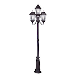 Bronze 4 Light 400 Watt 24.5In. Wide Outdoor Post Light With Clear Water Glass From The Hamilton Collection