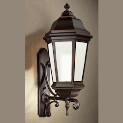 Troy Four Light Bronze Patina Wall Lantern